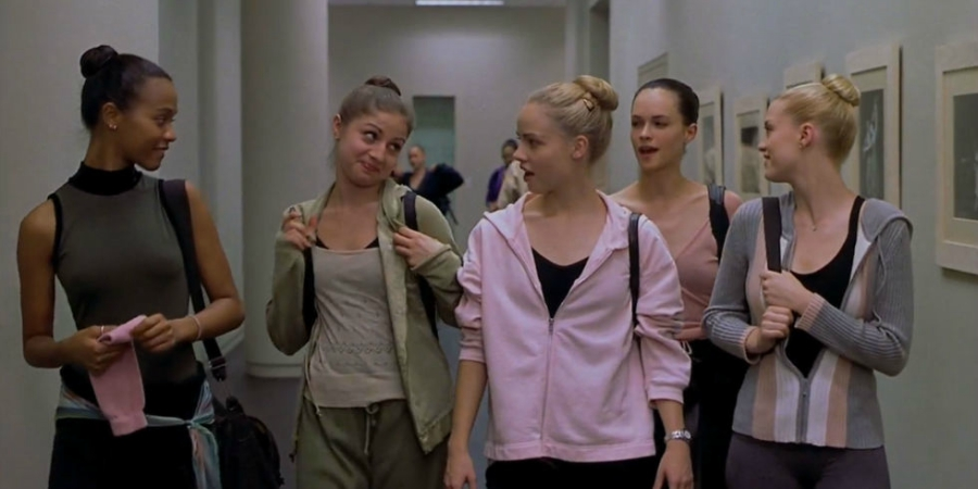 Still from Center Stage of dancers talking in hallway.