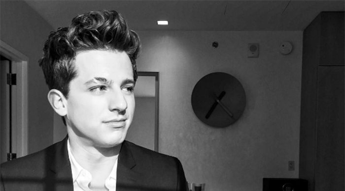 Black and white picture of Charlie Puth smiling
