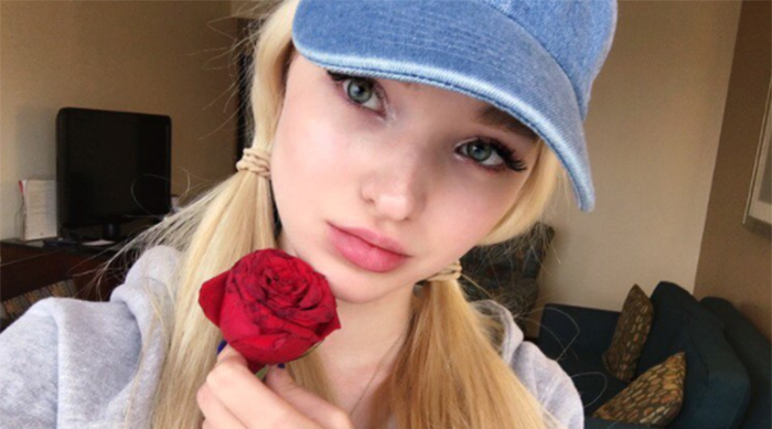 Disney Channel starlet Dove Cameron holding a rose
