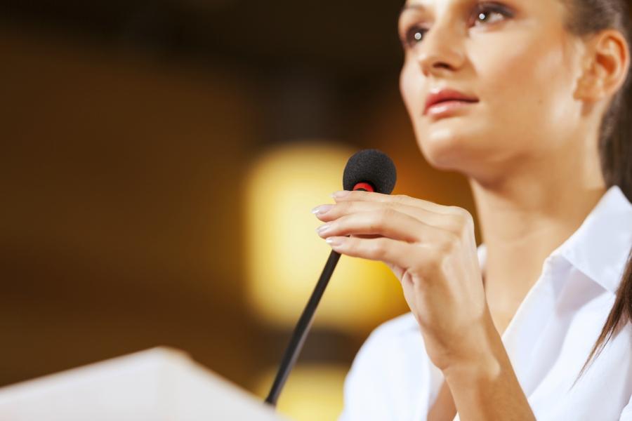 girl giving a speech at a podium