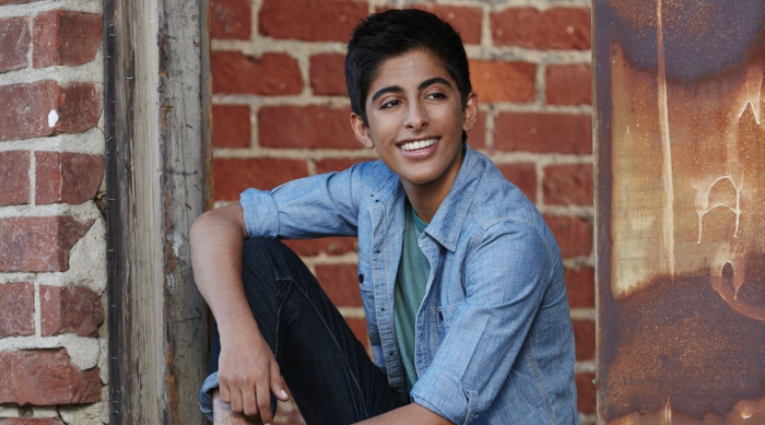 Karan Brar sitting in an abandoned warehouse