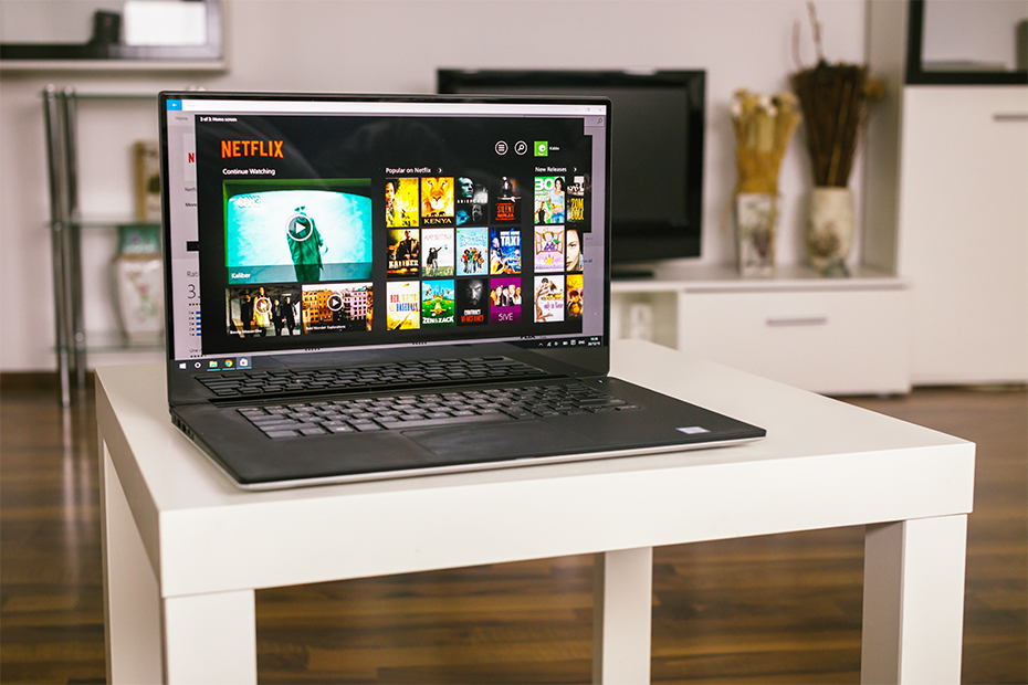 Laptop on a table viewing Netflix