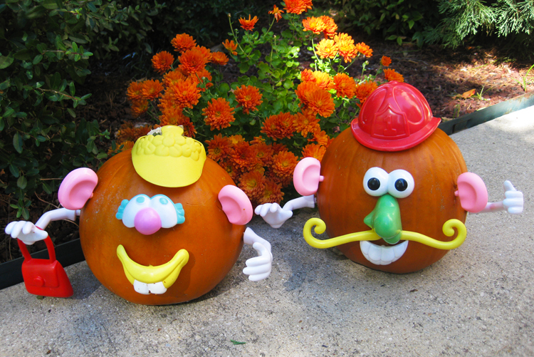 Mr. and Mrs. Potato Head on pumpkins