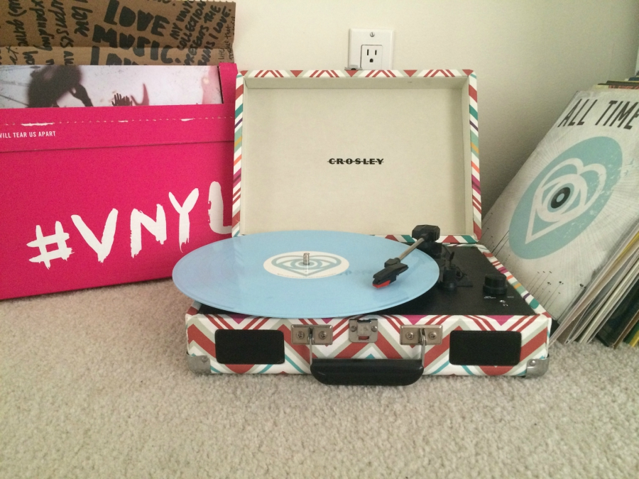 Future Hearts by All Time Low spinning on a Crosley vinyl record player next to a vnyl subscription box