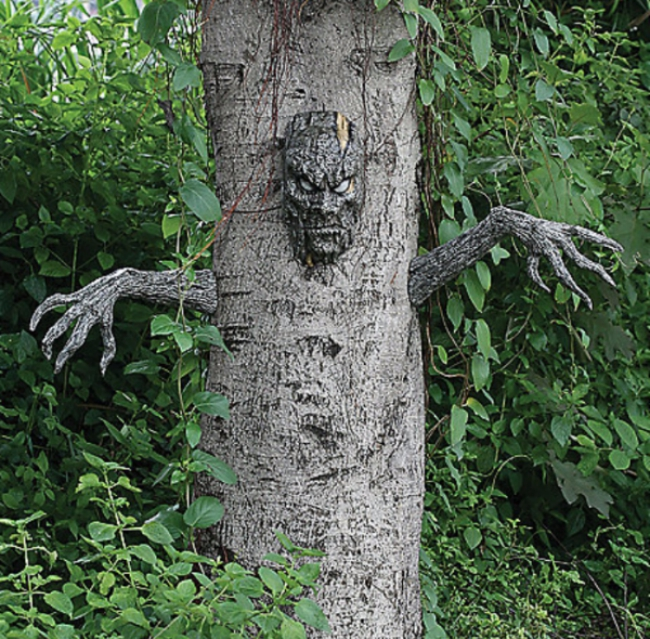 tree with a face and arms on it for a halloween decoration