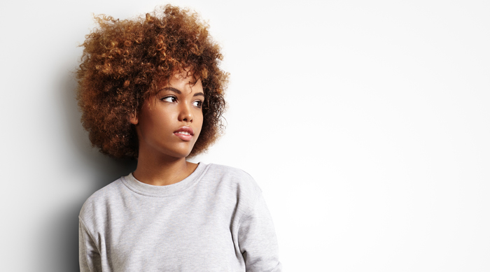 Girl wearing a gray sweatshirt