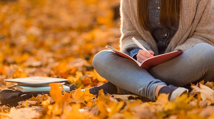 Girl Journaling in Fall