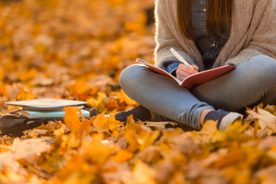 Girl Journaling in Fall