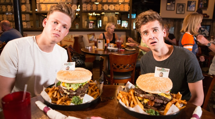 Joe Sugg and Caspar Lee eating a huge burger in Texas