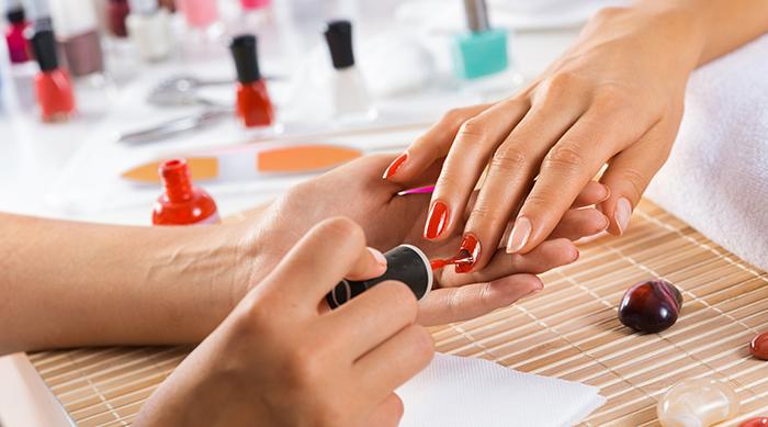 A girl getting a manicure at a salon