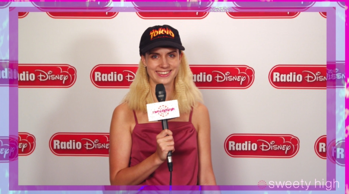 Pop singer-songwriter MØ holding a Sweety High microphone at Radio Disney