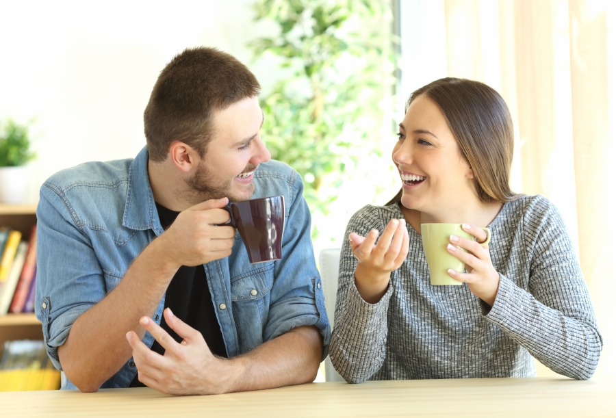 Teen girl and guy talking in a coffee shop