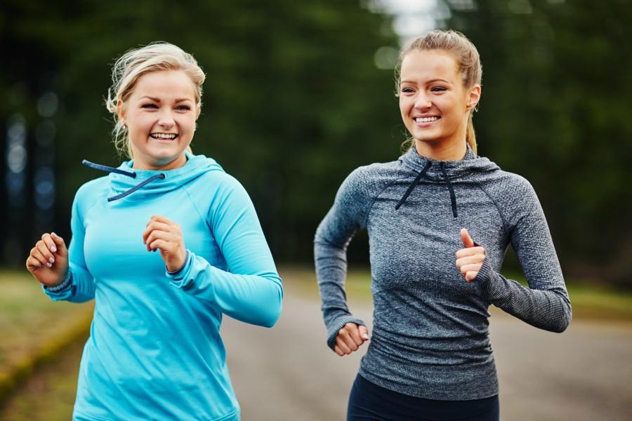 Two blonde teen girls running
