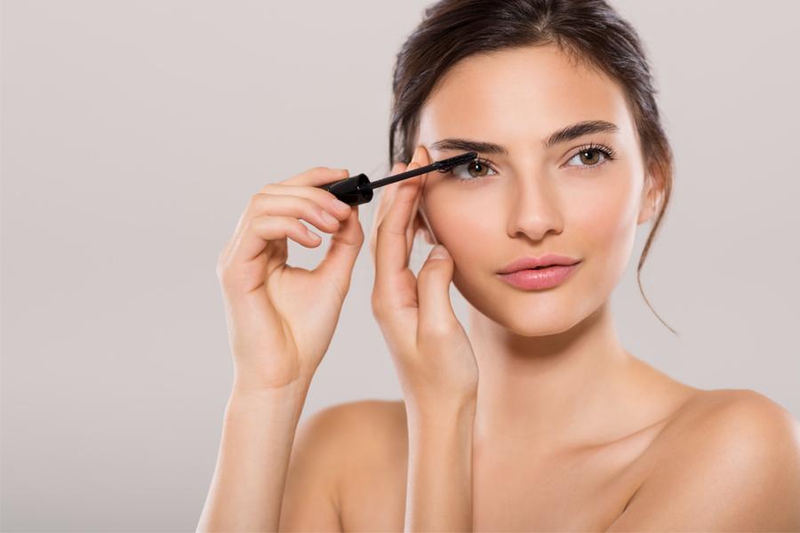 Girl brushing lashes