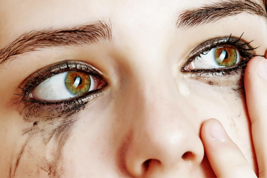 Girl with messy eye makeup