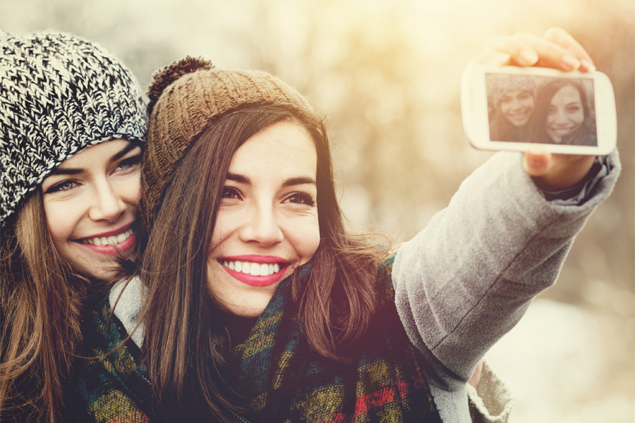 Girls in the snow taking a selfie