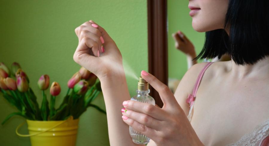 Girl spritzes on perfume