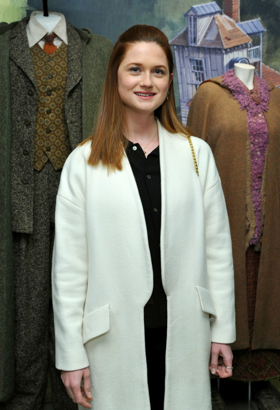 Bonnie Wright next to Harry Potter costumes