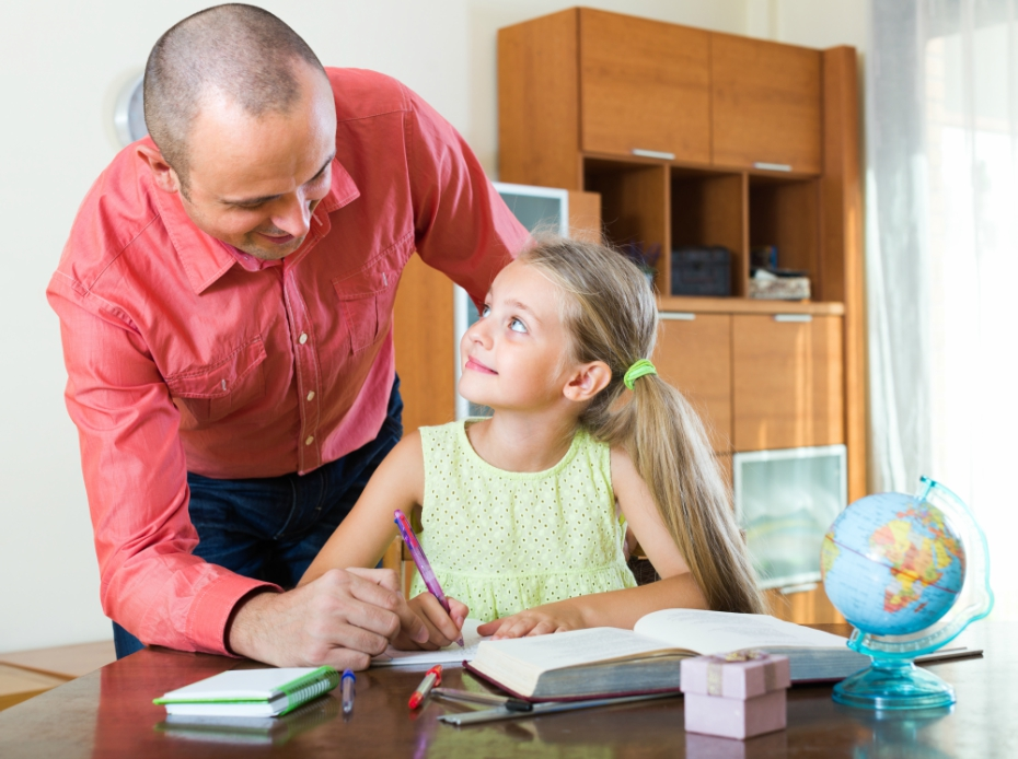 Young girl gets tutoring assistance from older man