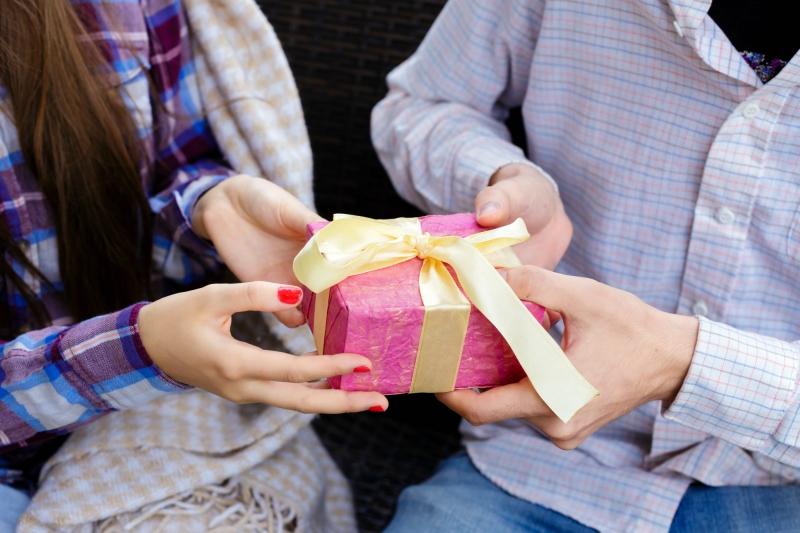 Girl taking gift from guy