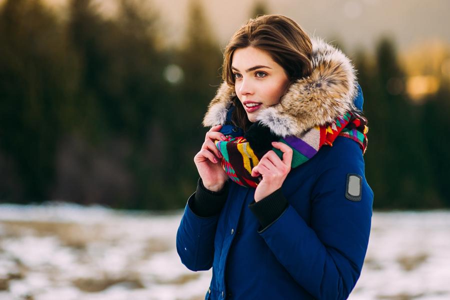 Girl wearing fur hoodie with pretty skin