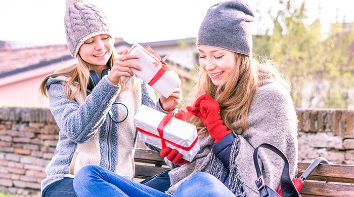 Girls gifting presents