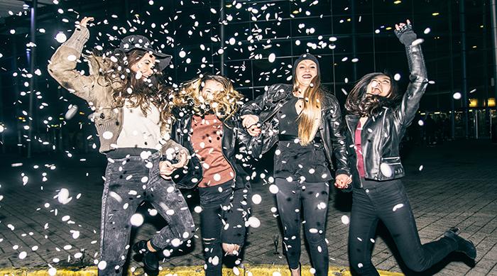 Girls celebrating with confetti on NYE