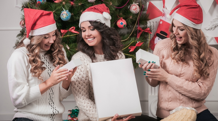 Girls exchanging holiday gifts