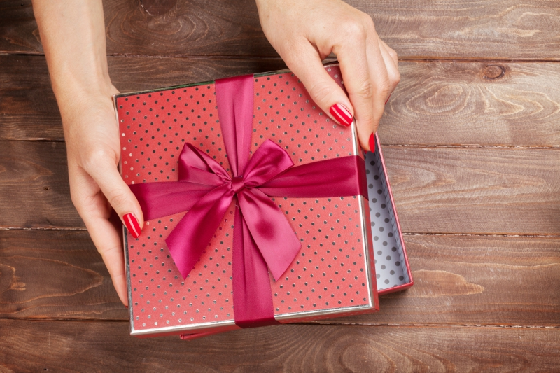 Girl wrapping a present