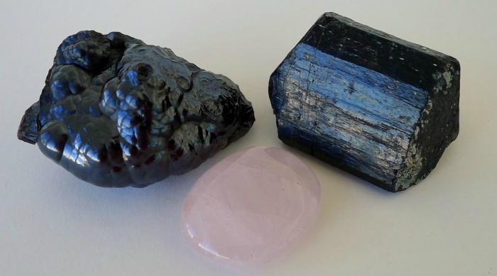 A hematite, rose quartz and black tourmaline crystal