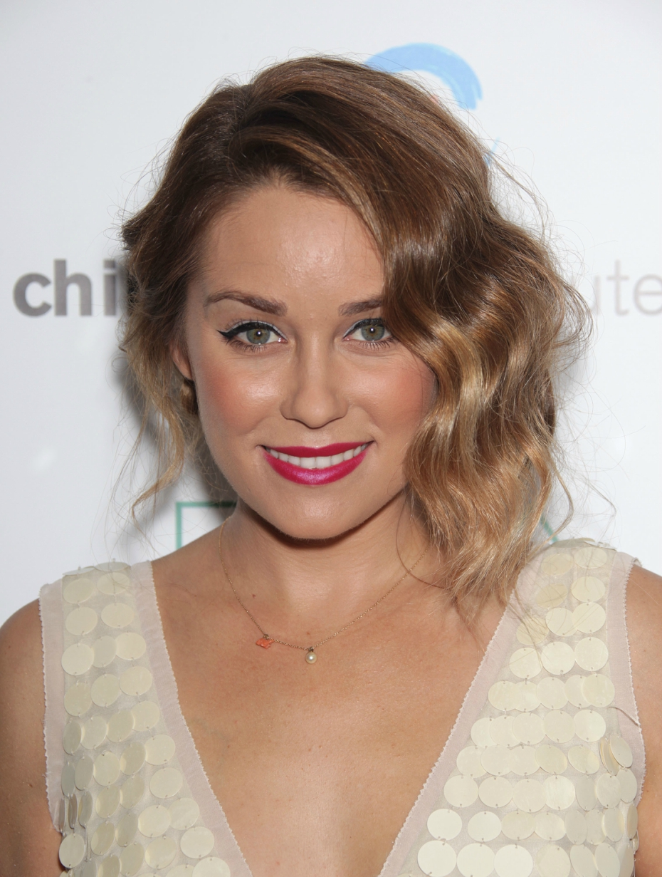 lauren conrad looks gorgeous and glamorous with a wavy updo