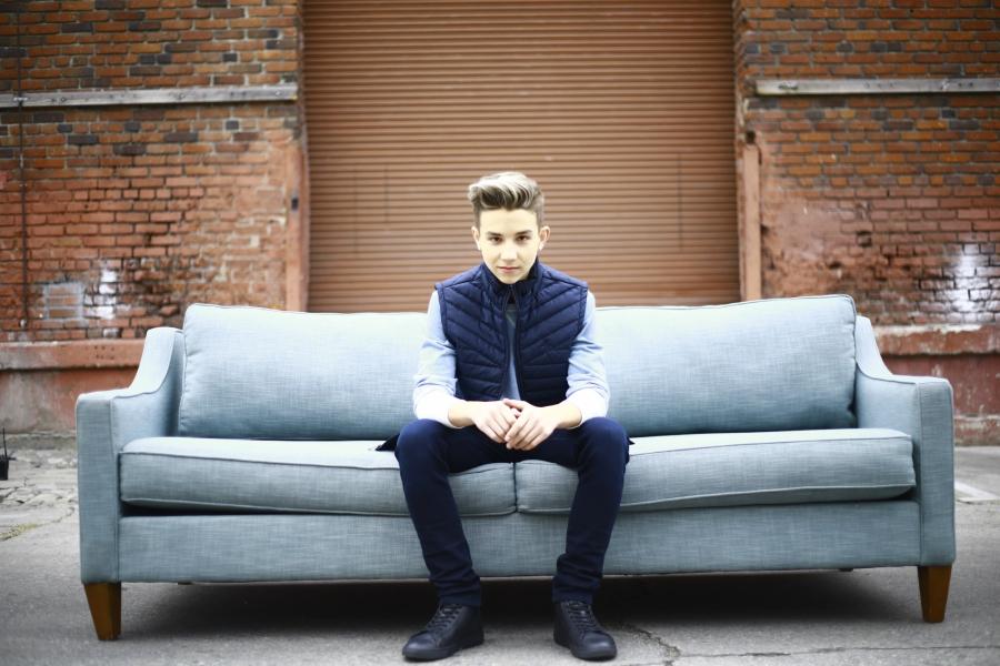Finn Matthews sitting on a couch