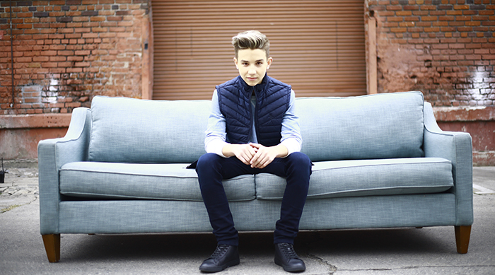 Finn Matthews sitting on a couch