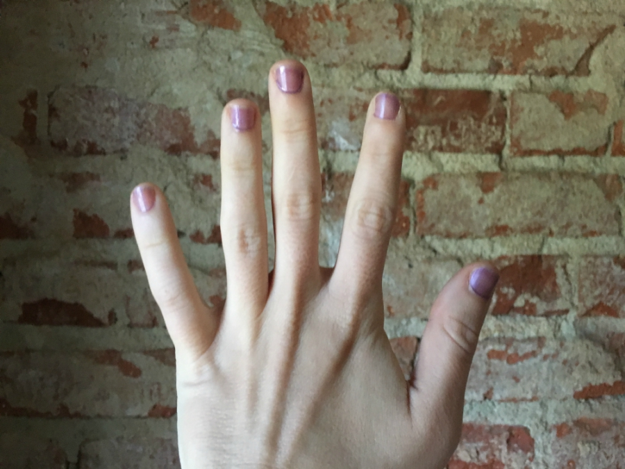 Purple nail polish on nails after one coat