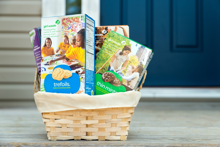 Girl Scout Cookie basket on a porch