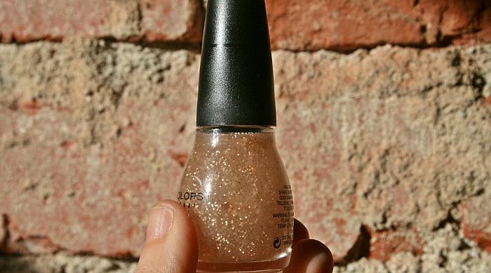 Sparkly gold nail polish final product.