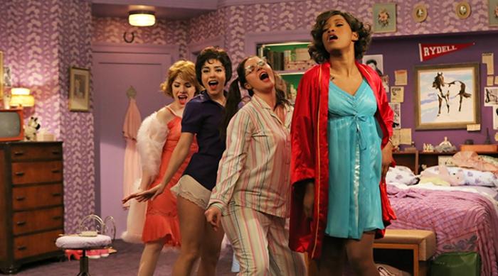 Still from Grease Live, girls singing Sandra Dee.
