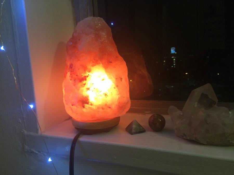 Himalayan Salt Lamp On A Windowsill Next To Crystals