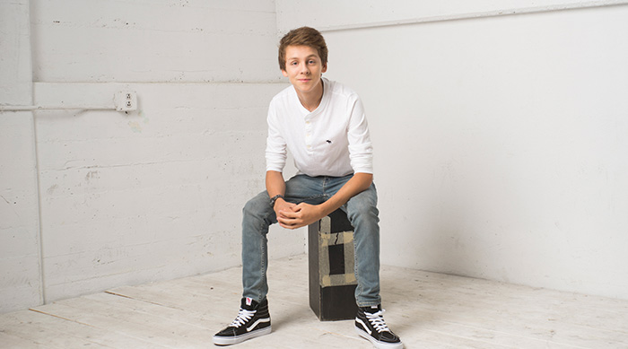 Jacob Bertrand sitting in a white room