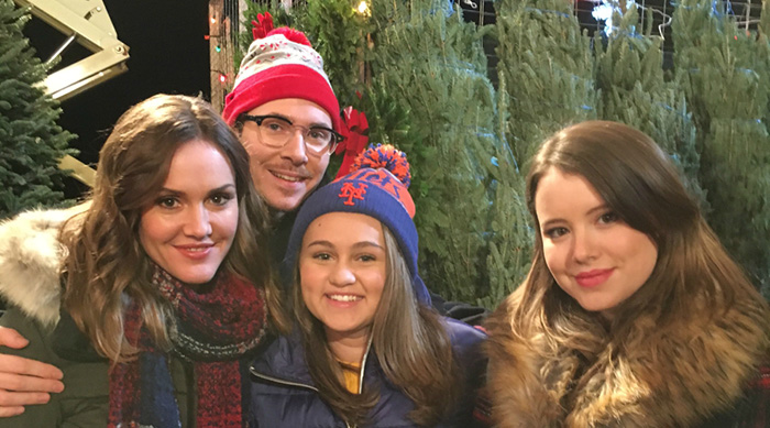 'Kevin Can Wait' cast in front of Christmas trees