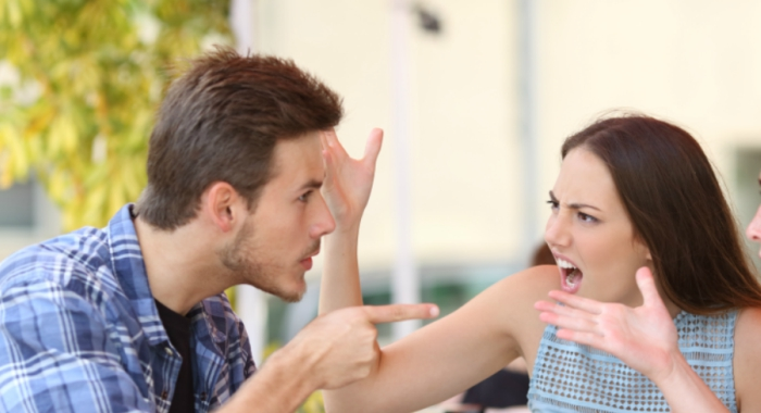 Guy and girl argue outside