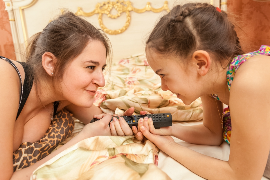 Two girls fighting over the TV remote control