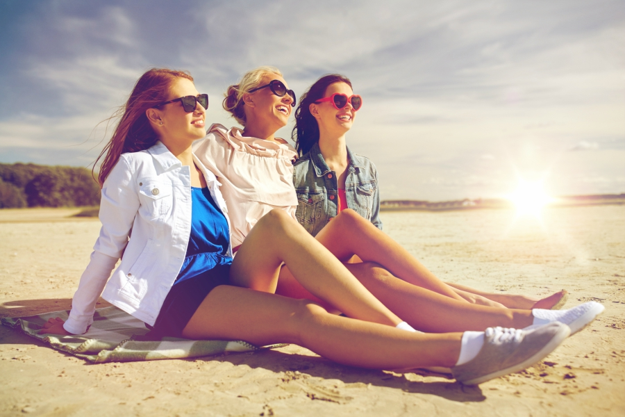 Teen girls smiling at beach