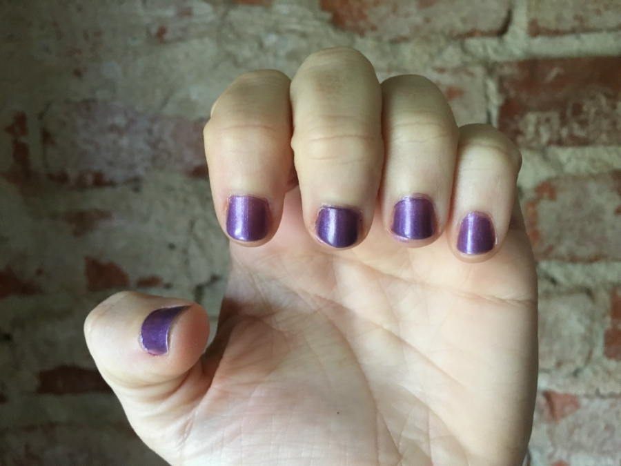 Final product purple polish on nails after three coats