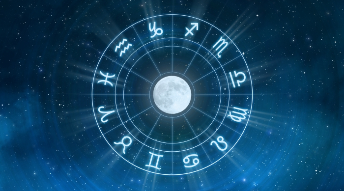 Circle of zodiac signs around a full moon