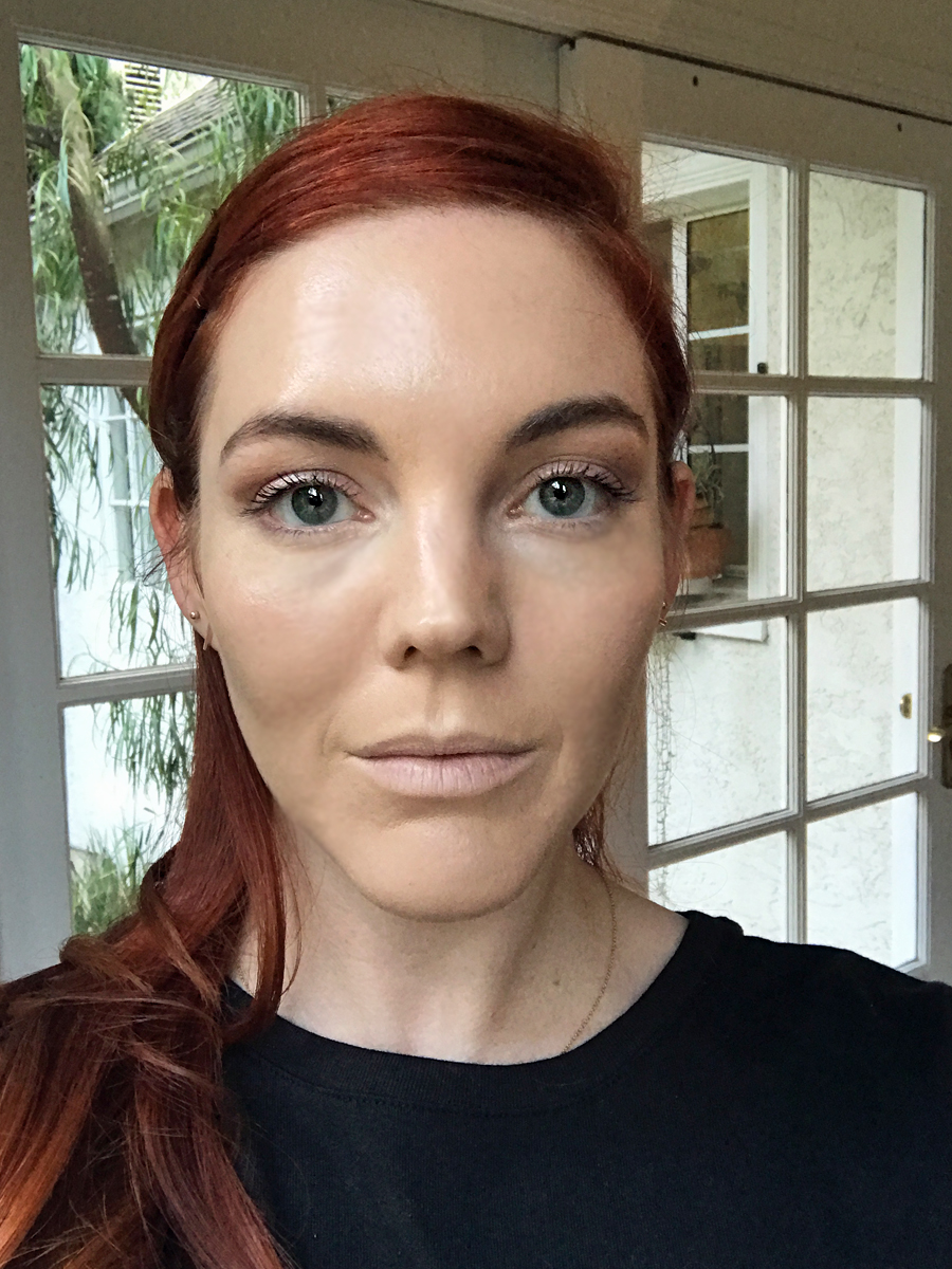 Face with full face of concealer and foundation
