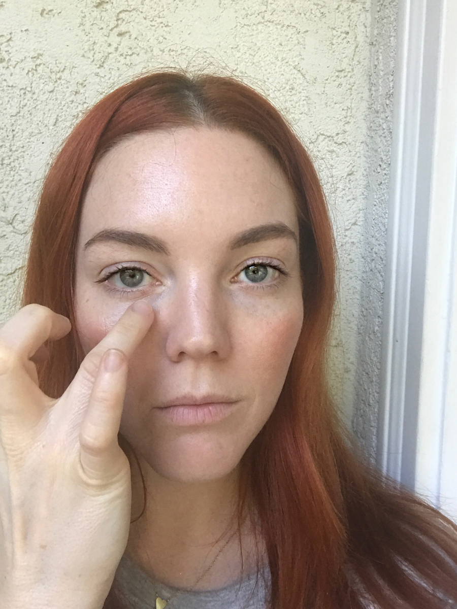 Apply concealer underneath eyes with finger