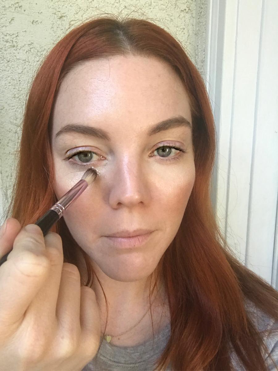 Use eyeshadow brush to apply glitter underneath eyes