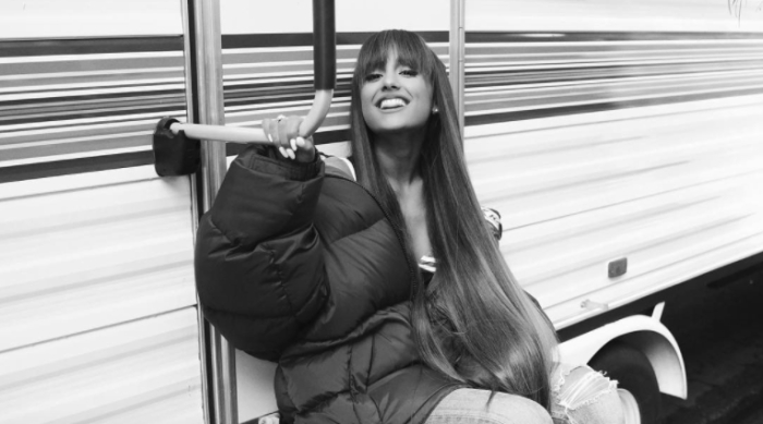 Ariana Grande smiling at camera in a black and white Instagram photo
