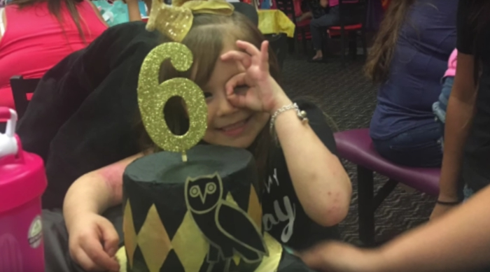 Little girl celebrating her 6th birthday with a Drake-themed party